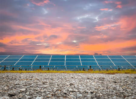 Solar plant(solar cell) with the orange sky, hot climate causes increased power production, Alternative energy to conserve the world's energy, Photovoltaic module idea for clean energy production.
