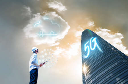 5G letters are on tall buildings, Concept of future technology 5G network wireless network that will control everything through electronic devices or have a short name called Internet of Things or IOT
