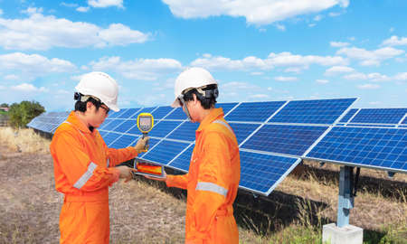 Engineer take the Thermoscan(thermal image camera) scan to the solar panel for a temperature check, Concept to used technology to check the damage in the Solar plant.