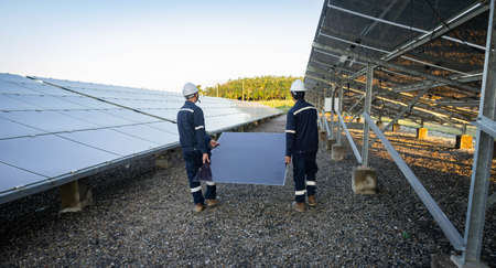 Technician is lifting the solar cell to replace the damaged one, Alternative energy to conserve the world's energy, Photovoltaic module idea for clean energy production.