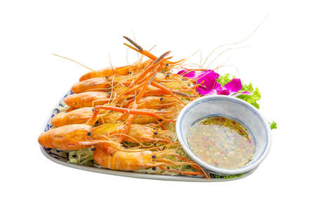 Large river prawns on a plate with vegetables and seafood sauce on white background Banque d'images