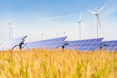 Solar plant with the wind farm in the summer season, hot climate causes increased power production and If strong winds will add the power generated, Alternative energy to conserve the world's energy. Imagens