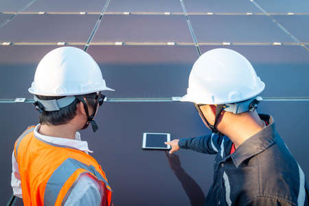 Engineers with investor check the operation of the solar farm(solar panel) systems, Alternative energy to conserve the world is energy, Photovoltaic module idea for clean energy production.