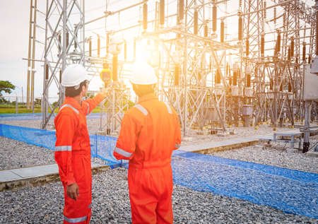Electrical engineers used a thermometer to check for faults in equipment sets, Also known as preventive maintenance to reduce the damage of equipment, Concept to professional engineer on industrial.