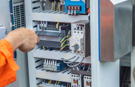 Engineers are checking the operation of the control panel, solar panel adjustment system according to the sun, Professional engineer concept about solar cell system.