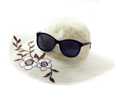 athletic wear: hat and sunglasses isolated on a white background
