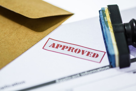 red seal: Stamp printed on the approved  application approved.