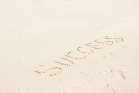 written: word success written in sand background Stock Photo