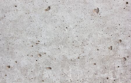Gray concrete wall close-up good for patterns and backgrounds.(Cement through the bad times, causing the air pocket.)