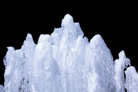 beauty fountain: fountain of pure sparkling light water  isolated on black background Stock Photo