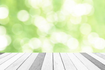 wood craft: Old wooden floor in front of abstract green color  bokeh background