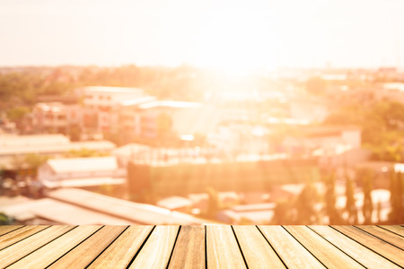 Perspective wood deck overlook the citys background atmosphere as the sun sets. Services include product display  template Stock Photo
