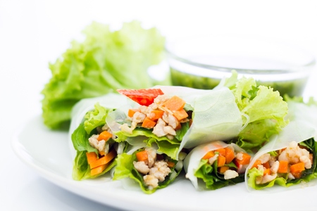 Fresh vegetable salad roll in noodle tube isolated on white background Stock Photo