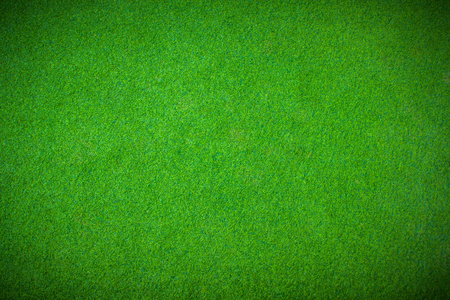 Green grass background vignette or the green nature wall texture Ideal for use in the design fairly. Stock Photo
