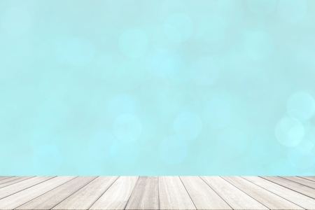 Art wood floor at  painted blue colour wall bokeh background. Stock Photo