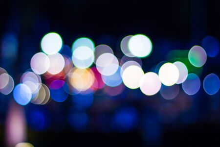 Bokeh background with colorful lights in the city at night.It represents the hustle and bustle of urban people. Reklamní fotografie