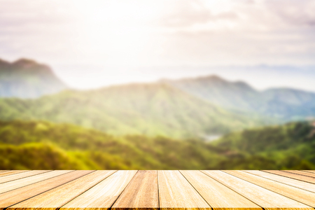 include: Perspective wood deck overlook the mountains  background atmosphere as the sun sets. Services include product display  template