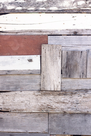 Old wooden wall that lasts a long time. Caused by time decay. The wall is a vintage style home.