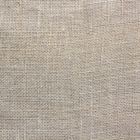Natural fabrics  sackcloth woven texture background in yellow beige cream as a light brown vintage background.