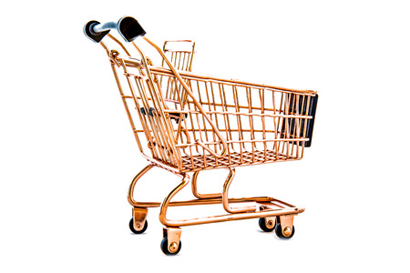 sell: Shopping cart golden yellow isolated on white background.