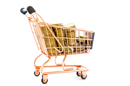 Shopping Cart Filled with Gold coins on a white background online Trading Concepts.