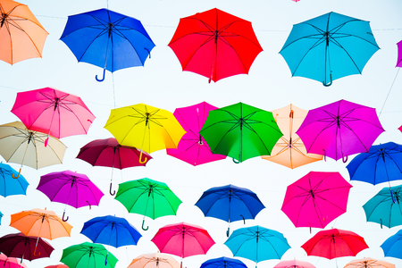 umbrellas colorful shade background is sky Decoration hanging on to the streets to celebrate the beauty of summer.