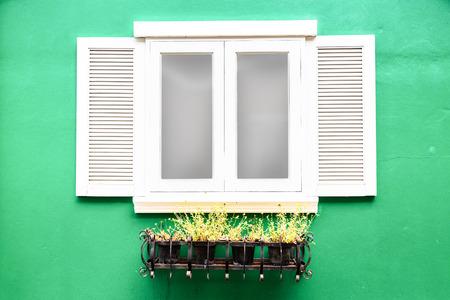 vintage wood window stye on old concrete wall texture background. Stock Photo