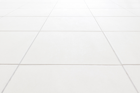 White tile floor backgroundThe morning sun hits the top. used in interior design.