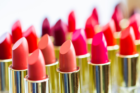 Colorful lipstick put together beautifully used for cosmetic articles.