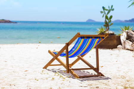 Beach chair in front Beautiful tropical beach of Summer sea background.