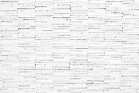 Fondo de textura de pared de ladrillo blanco de diseño de estilo moderno decorativo desigual. Foto de archivo
