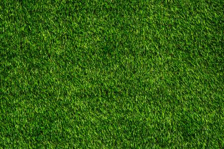 Sfondo verde del tappeto erboso artificiale per il design esterno e fiere commerciali.