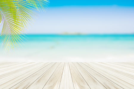 wood deck on blur blue sky and beautiful tropical beach of Summer sea background  .The sand is empty for product placement .