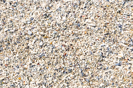 white sea stone texture background on beach in summer for wall design and natural background, business concept in summer.