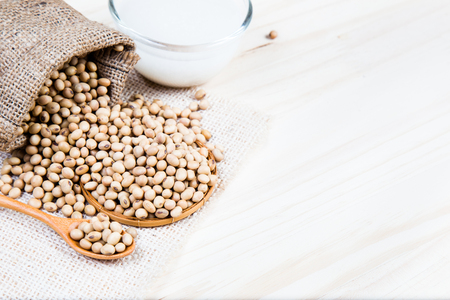 Soybean milk and soy beans are placed on basket with wooden background with copy space for your text. 스톡 콘텐츠