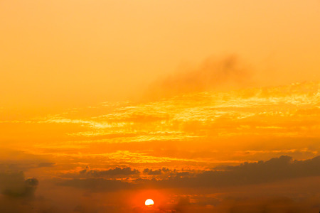Nature background of orange sunset and sunrise sky concept with dramatic sunset twilight sky clouds background. 스톡 콘텐츠