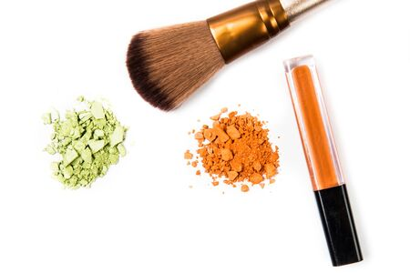 Close-up Cheek brushes and green orange colour cosmetic powder isolated on white background.Use the makeup concept.