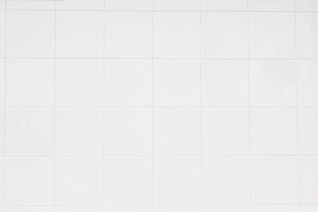 Texture de carreaux de mur en céramique blanche pour la décoration de la chambre.