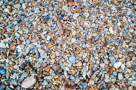 color sea stone texture background on beach in summer for wall design and natural background, business concept in summer.