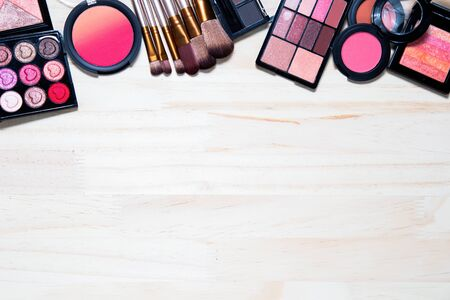 Decorative cosmetics of professional make-up girls for beauty placed on white wooder background.Business cosmetics concept and includes articles about beauty. Zdjęcie Seryjne