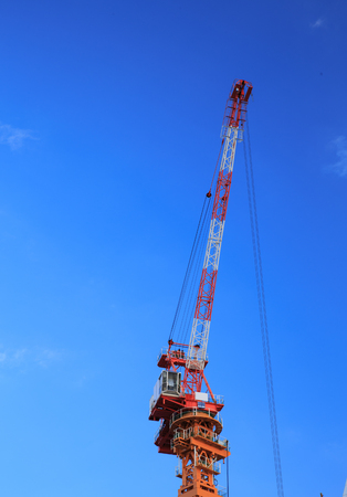 steel: Construction site with cranes on sky background Stock Photo