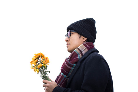 beneath: Asian man holding flowers beneath a large tree.  on white backgroud