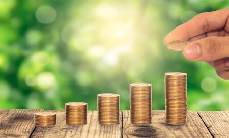 represent: Coins represent Growth on a green background Stock Photo