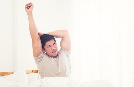 Man waking up in the morning and suffering because of body aches Stok Fotoğraf