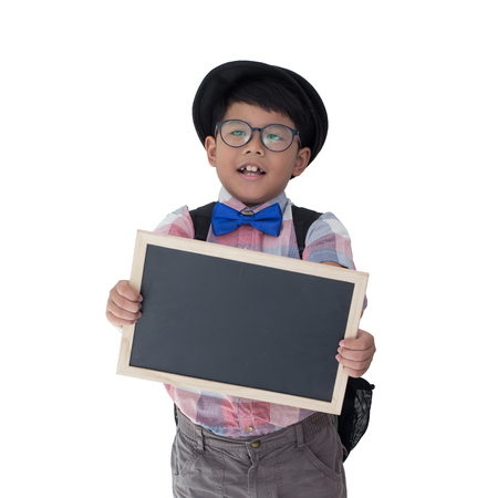 little boy holding a blackboard in isolated white background and