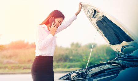 Beautiful Business woman upset because of car crash.