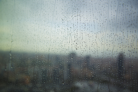 Art pattern of water drop on tower window after rain, for background.