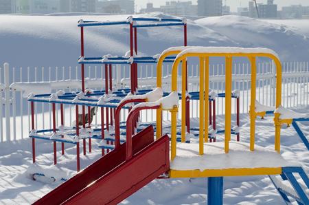 playground equipment: Playground equipment in snow Stock Photo