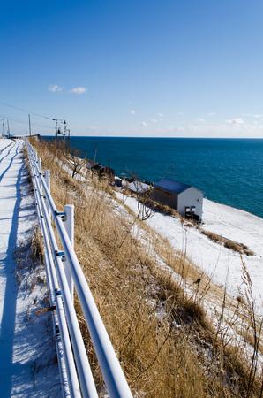 guard rail: Blue sea and white road