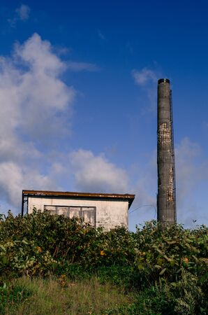 vacant land: Old chimneys and buildings Stock Photo